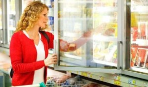 Woman shopping for frozen food in a supermarket.
